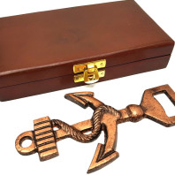 Metal opener in a wooden box - an anchor