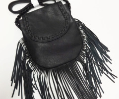 Black shoulder bags with fringes