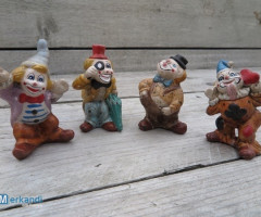 Set of 4 porcelain clowns.
