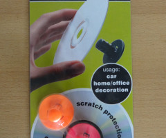 Self-adhesive disc clips