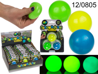 Throwing and kneading balls glow in the dark