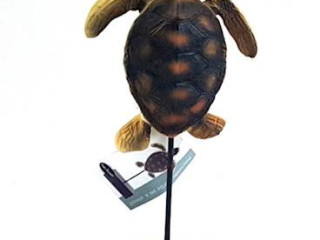 Decorative turtle on the HOME ACCENTS stand
